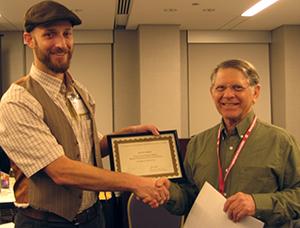 Holmes receives SAW prize