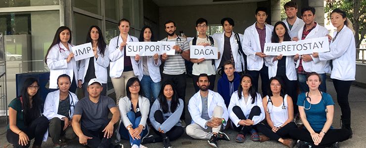 JMP students with signs in support of DACA
