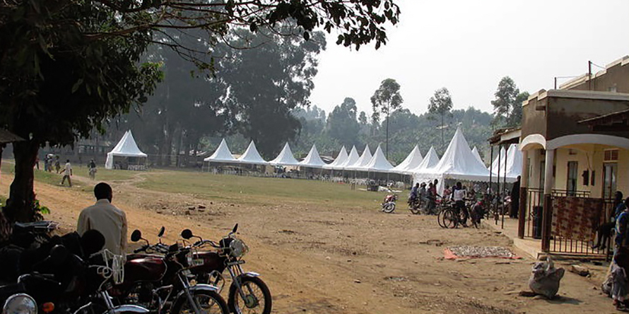 Image of rural African community with white tents in background