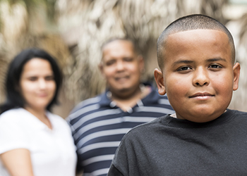 Latino boy with parents