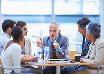 Health care professionals meet in a board room