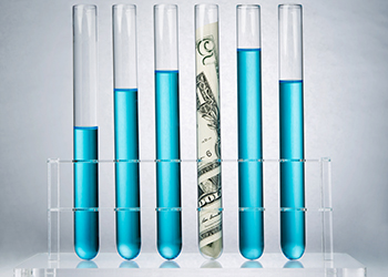 test tubes with U.S. currency