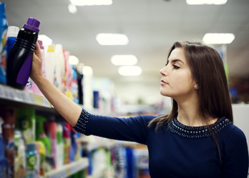 woman selects detergent