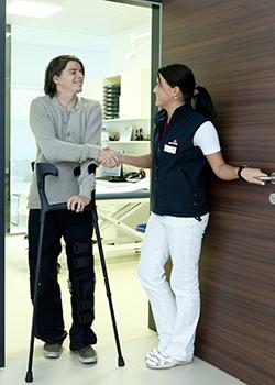 medical professional greets patient