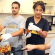 Student volunteers prepare a meal for clients at the Berkeley Food and Housing Project.
