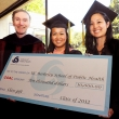 2012 Class Gift Committee co-chairs Hue Le M.P.H. '12 and Samantha Quon B.A. '12 present a check to Dean Stephen Shortell.