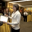 Dr. Ray Baxter presenting certificate to Emily Murphy.