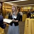 Dean Stephen Shortell presenting a certificate to Katherine Schaff.