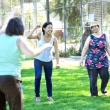 Students lead clients at the Berkeley Food and Housing Project in stretching exercises.