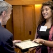 Dean Stephen Shortell presenting certificate to Yasmina Mohan.
