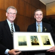 Professor Emeritus Thomas Rundall presents Dean Shortell with a gift from the School, created by Steve and Nancy Selvin