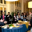 With a captive audience at the 5th annual KP Public Health Scholars reception, Ray Baxter, Kaiser Permanente, extols the virtues of the KP Public Health scholars