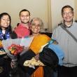 Graduating student Lakshmi Rangarajan (left) with guests.