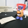 Design Spud gets ready to greet Innovation Feast guests at the registration table.