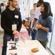 Simone Saldanha (R, Team Josephine) chats with Innovation Feast guest Mike Yuen of Blurb.