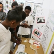 Team Civil Labs' co-collaborators from the East Oakland Youth Development Center check out the marketplace at Innovation Feast.