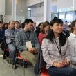 Innovation Feast attendees enjoy the student presentations. In the front row is Emily Yao of Murple (2015).