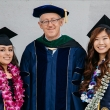 Dean Bertozzi with student speakers at Commencement