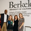 Five people pose in front of a UC Berkeley sign on a wall