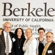 Five people pose for a photo underneath a UC Berkeley sign