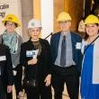 Six people await building tour
