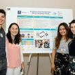Undergraduate students and Fung Fellows stand in front of a research poster