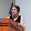 Catherine Metayer speaks from podium
