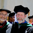 Two older men in caps and gowns