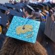 Close up of decorated grad cap.