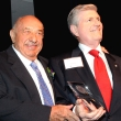 Kenneth E. Behring (left), founder of the Wheelchair Foundation and the WaterLeaders Foundation, accepts the International Public Health Hero award from Richard D. King, past president of Rotary International.