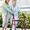 Elderly woman with family caregiver