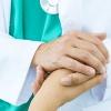 doctor consoles patient