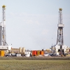 hydro- fracking derricks drilling natural gas on a plain