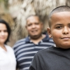 Latino child with parents