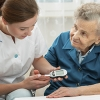 Patient receives blood glucose test from nurse