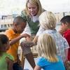children in school with teacher