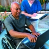 caregiver and patient with laptop