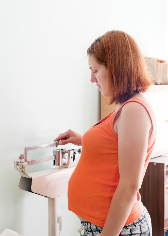Pregnant woman weighing